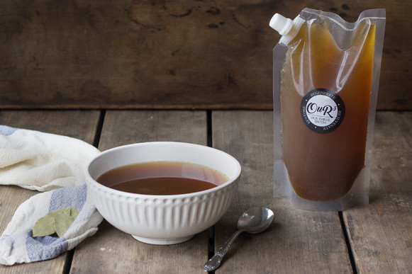 Bone broth in a pouch sitting next to a bowl