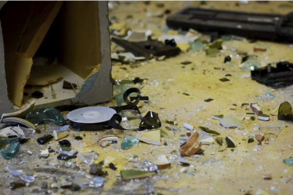 Photo of broken glass and debris in a rage room