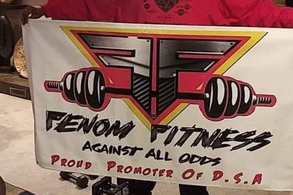 Dalen Banks holding a custom Fenom Fitness sign