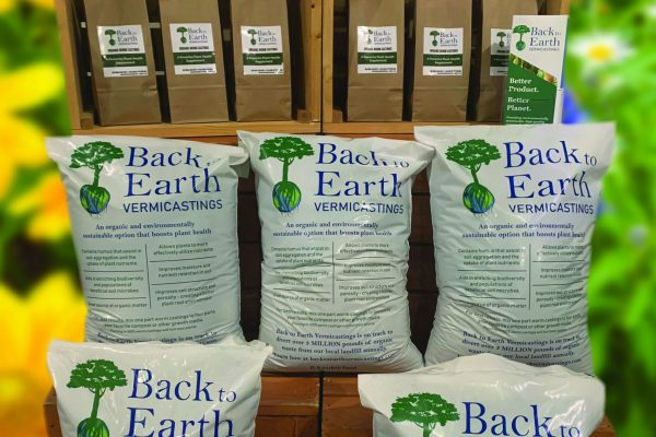 Several bags of Back to Earth Vermicastings in a display
