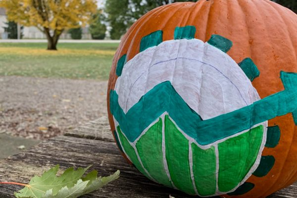 Traction Ag logo painted on a pumpkin