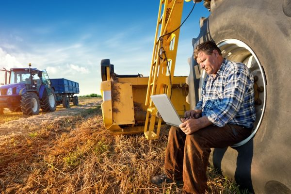 Farmer sitting in a large tractor tire