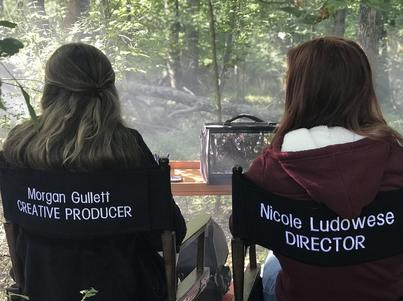 Morgan Gullett, Creative Produce, and Nicole Ludowese, Director, behind the scenes of a film