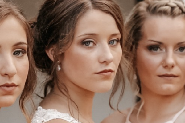 A video still of a bride and her bridesmaids