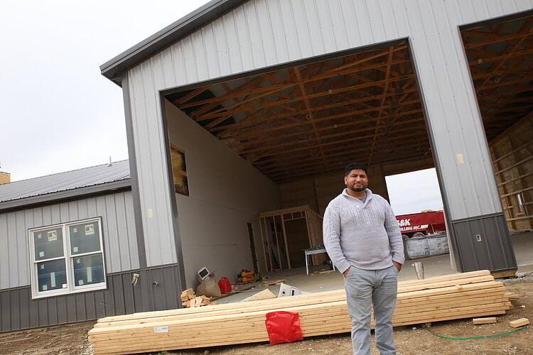 David De Leon in front of a build