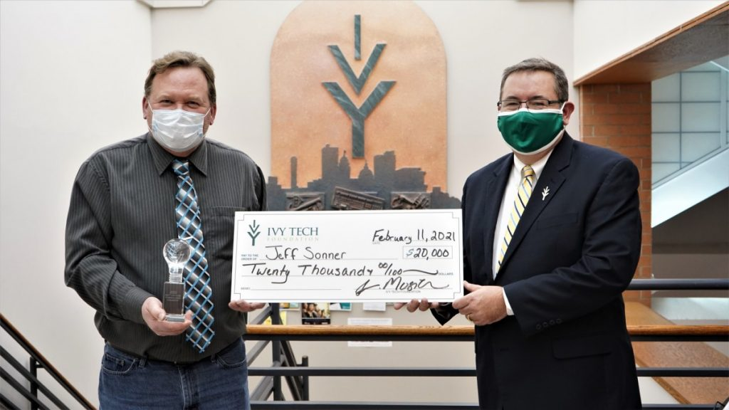 Jeff Sonner with a $20,000 check from Ivy Tech University