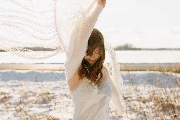 Bride in a shawl on the beach